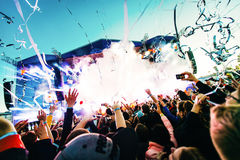 Dancing people having fun in the crowd at music festival royalty free stock photos