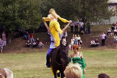 August 28, 2017: A girl in a beautiful long dress makes a beautiful figure on a horse in Ukraine, Odns region, August 28, 2017 Royalty Free Stock Image