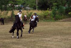 August 28, 2017: Girls ride beautiful horses at a horse-racing event in Ukraine, Odns region, August 28, 2017 Stock Photos
