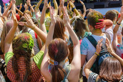 Dancing people no the annual holi festival stock image