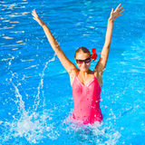 Dancing and playing in water Stock Photography