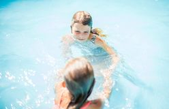 Dancing in pool. royalty free stock photos