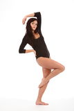 Dancing pose by beautiful young girl in leotard Royalty Free Stock Photography
