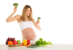 Dancing Pregnant Woman With Fruits And Vegetables Stock Photos