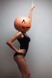 Dancing pretty woman with pumpkin Stock Photography