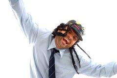 Dancing reggae. Man smiling using a jamaican hat and dancing reggae stock image