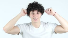 Dancing Relaxing Young Man with Curly Hairs, white Background stock footage