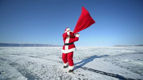 Dancing Santa Claus. Christmas holidays, Santa Claus walks around the lake Baikal, Siberia stock video footage