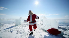 Dancing Santa Claus. Christmas holidays, Santa Claus walks around the lake Baikal, Siberia, Russia