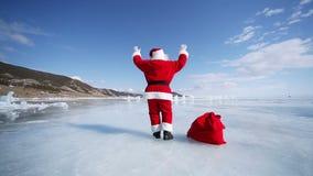 Dancing Santa Claus. Christmas holidays, Santa Claus walks around the lake Baikal, Siberia, Russia stock video