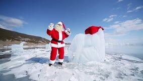 Dancing Santa Claus. Christmas holidays, Santa Claus walks around the lake Baikal, Siberia, Russia stock video footage
