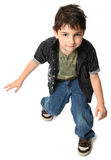 Dancing Seven Year Old Boy. Seven year old boy dancing over white background stock images
