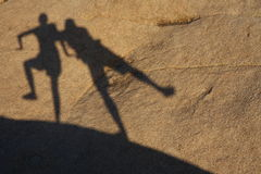 Dancing shadows. Two shadows dancing in the sunlight Royalty Free Stock Photography