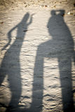 Dancing shadows of two persons Royalty Free Stock Images