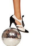 Dancing shoe and leg on disco ball Stock Photo