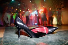 Dancing shoes. Taking the shoes off on the dancing floor Royalty Free Stock Image
