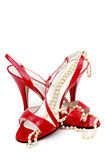 Dancing shoes. Red shoes with a pearl necklace stock photography