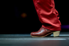 Dancing shoes feet and legs male dance flamenco for print stock photo