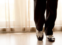 Dancing shoes feet of male ballroom, latin, salsa and swing danc Royalty Free Stock Images