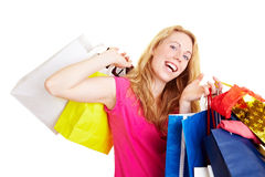 Dancing with shopping bags Stock Images