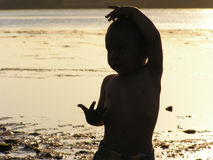 Dancing silhouette. Child dancing in the sunset stock photos