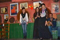 Flamenco, the music of Andalusia. Dancing and singing Flamenco in a bar in Sevilla, in Betis street, along the Guadalquivir river in Seville, Spain, in April stock images