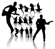 Dancing and Singing Peoples Silhouettes Stock Image