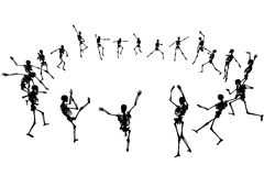 Dancing skeletons. Editable vector skeleton silhouettes dancing in a ring with each skeleton as a separate object Stock Photos