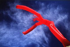 Dancing in the sky. Red symbol of joy in the sky stock photo