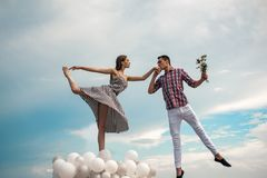 Dancing in the sky. Couple in love. Ballet couple into love relations. Ballet dancers falling in love. Romantic stock photography