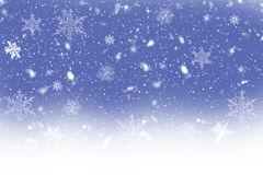 Dancing snow flakes on a blue background. A winter illustration: dancing snow flakes on a blue background Stock Image