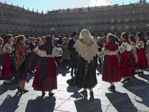 Dancing in the Square. SALAMANCA, SPAIN - FEBRUARY 5, 2013: Popular musicians and dancers. Commemoration of St. Agatha on 5 February is a very popular festival Royalty Free Stock Images