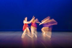 Dancing on stage. Girl jazz dancing movement captured Stock Photography