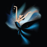 Dancing with the stars. A woman dancer in a starry dark blue dress merging with the abstract dark background Royalty Free Stock Image
