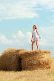 Dancing on straw bales Stock Photo