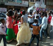 Dancing on the street in Panchgani. Wedding celebration procession stock photography