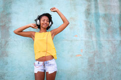 Dancing in the street. Young woman having fun listening music and dancing Royalty Free Stock Photos