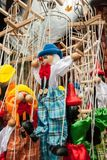 Dancing strings wooden puppet clowns and pinocchios toys hanging. In a stand Royalty Free Stock Photo