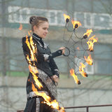 Dancing and stunts with fire. 23.02.2017.Russia.Saint-Petersburg.Dancing young girls with the rotation of the chains with lights Stock Photo