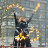 Dancing and stunts with fire. 23.02.2017.Russia.Saint-Petersburg.Dancing young girls with the rotation of the chains with lights Stock Image