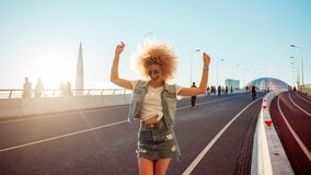 Dancing stylish girl on a city walk Royalty Free Stock Images