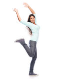 Dancing Success Winner Woman. Celebrating Modern Young Woman dancing isolated on White Stock Photography