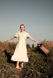 Dancing with suitcase Stock Photography