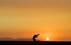 Dancing at Sunset. Jumping into the beauty of sunset Royalty Free Stock Image