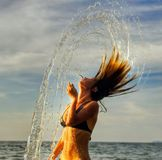 Dancing in the sunset drops Stock Images