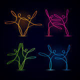 Dancing swirly line figures glowing set. Dancing swirly line figures glowing on black background Stock Photo
