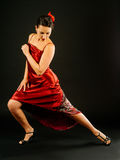 Dancing the tango. Photo of a beautiful woman dancing the tango over dark background Stock Photos