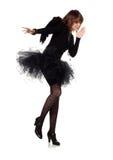Dancing teenage girl in costume of black angel Stock Images
