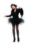 Dancing teenage girl in costume of black angel Royalty Free Stock Photos
