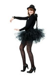 Dancing teenage girl in costume of black angel Stock Photos
